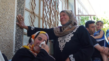 The mother of Sa'ad Dawabshe and a relative grieve. (Photo: Dan Cohen)